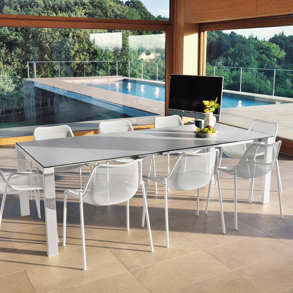 Mesa extensible round rectangular de acero barnizado for Muebles terraza outlet